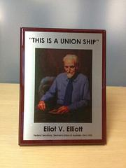 "Union Ship Plaque - Plaque depicting E.V. Elliot saying ""This is a Union Ship"" perfect for the crew room on board. The money goes to the MUA fighting fund."